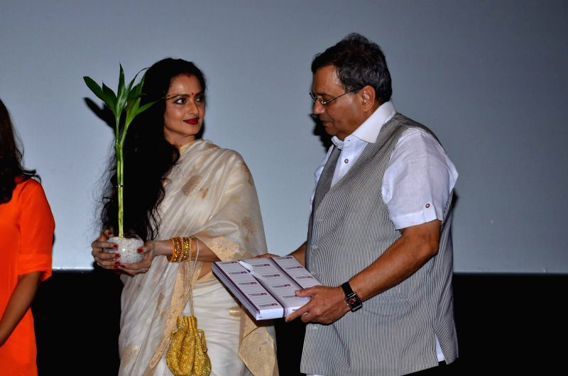Veteran actor Rekha and filmmaker Subhash Ghai during the Cinema festival organized by Whistling Woods International, in Mumbai, on May 17, 2014. - Rekha