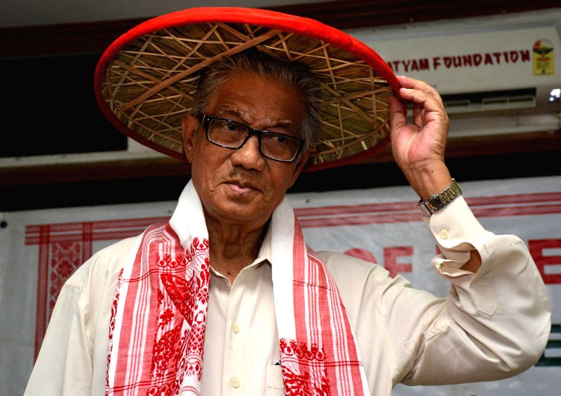 Veteran Assamese actor Abdul Mazid being felicitated with traditional Assamese ``Japi`` at ``Guest of the Month`` function organised by the Guwahati press club in Guwahati on June 16, 2014.