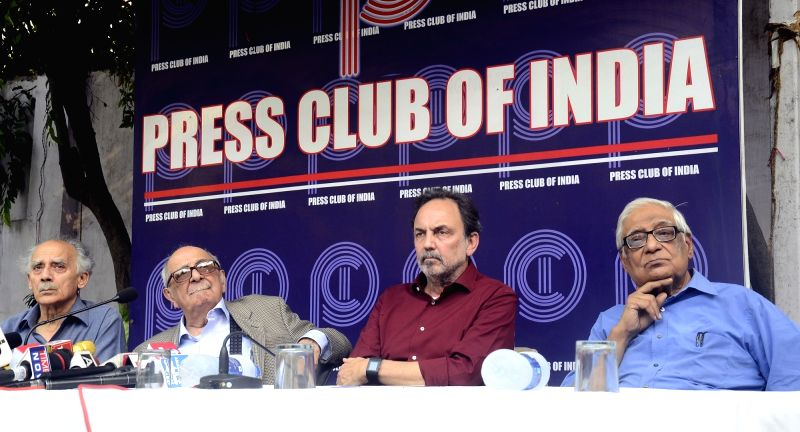 Veteran journalist and former union minister Arun Shourie, Fali Sam Nariman,  NDTV co-founder Prannoy Roy and HK Dua during a protest meet organised at the Press Club of India following ... - Arun Shourie and Prannoy Roy