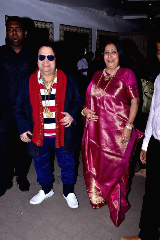 Veteran singer-composer Bappi Lahiri with his wife Chitrani Lahiri at the wedding reception of lyricist Sameer Anjaan's daughter Suchita in Mumbai, on Jan 22, 2019.
