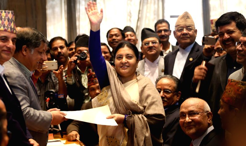 Vice-Chairperson of the Communist Party of Nepal (Unified Marxist-Leninist) (CPN-UML) Bidya Devi Bhandari (C) waves hands after filing her nomination for the ...