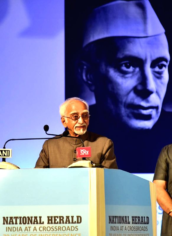 Vice President Hamid Ansari addresses during the re-launch of National Herald news paper at Ambedkar Bhavan in Bengaluru on June 12, 2017.