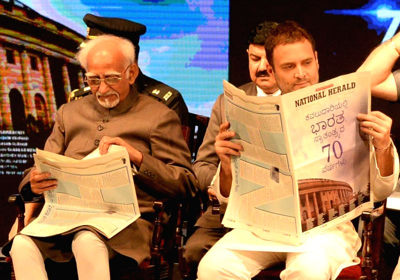 Vice President Hamid Ansari and Congress Vice President Rahul Gandhi during the re-launch of National Herald news paper at Ambedkar Bhavan in Bengaluru on June 12, 2017. - Rahul Gandhi