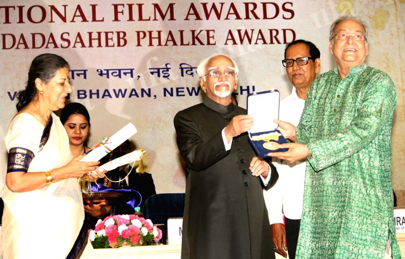 "Vice President Hamid Ansari and Information and Broadcasting Minister Ambika Soni presenting the Dadasaheb Phalke Award to Soumitra Chatterjee at the ""59 National Film Awards"",.. - Ambika Soni and Soumitra Chatterjee"