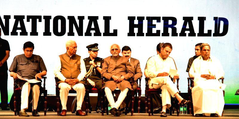 Vice President Hamid Ansari, Karnataka Governor Vajubhai Rudabhai Vala, Chief Minister Siddaramaiah, Congress Vice President Rahul Gandhi and party leader Oscar Fernandes during the ... - Siddaramaiah, Rahul Gandhi and Fernandes