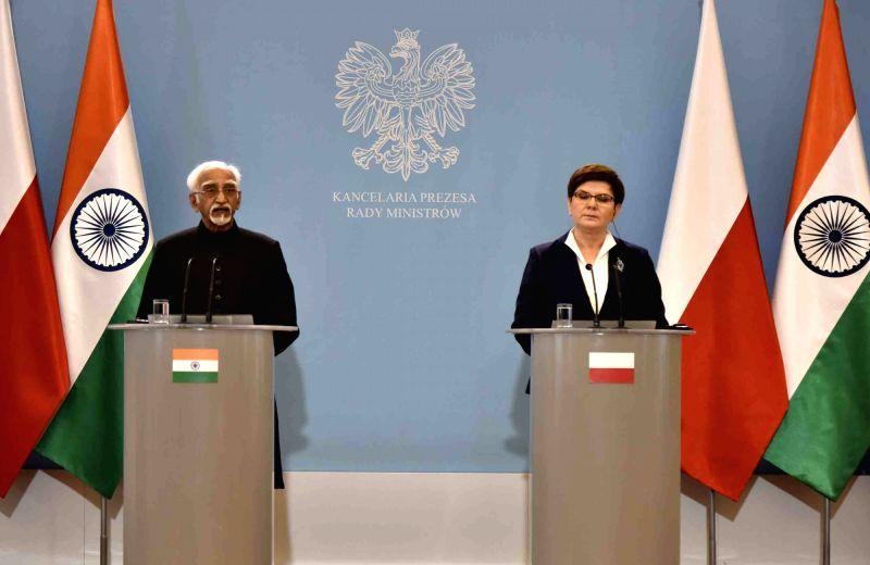 Vice President M Hamid Ansari and Poland Prime Minister Beata Szydlo joint press statement following delegation level talks, in Warsaw, Poland on April 27, 2017. - Beata Szydlo