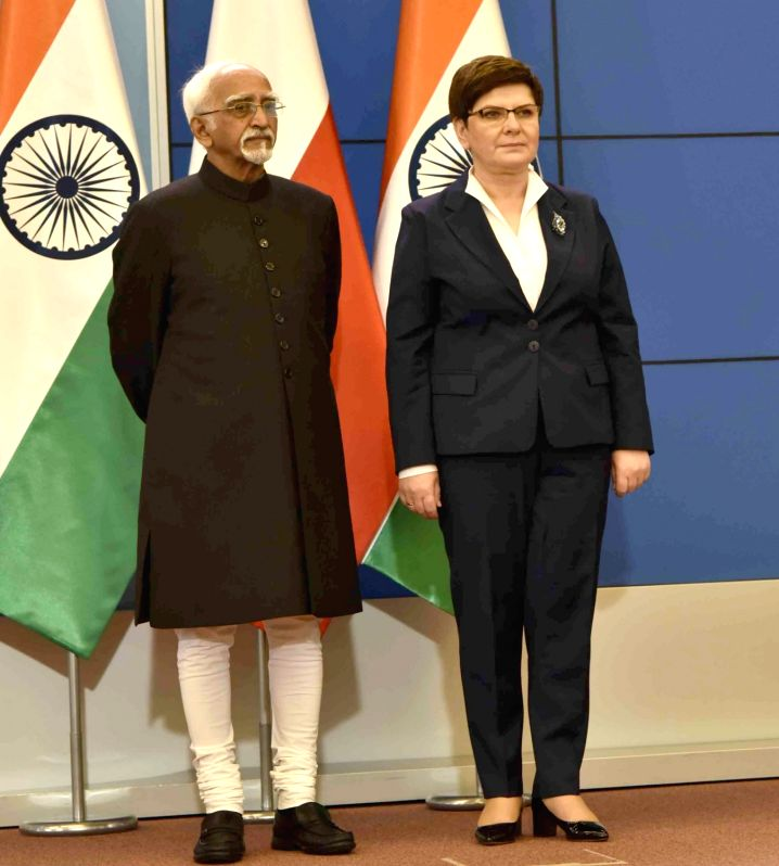 Vice President M Hamid Ansari and Poland Prime Minister Beata Szydlo at the signing of MoUs following delegation level talks, in Warsaw, Poland on April 27, 2017. - Beata Szydlo