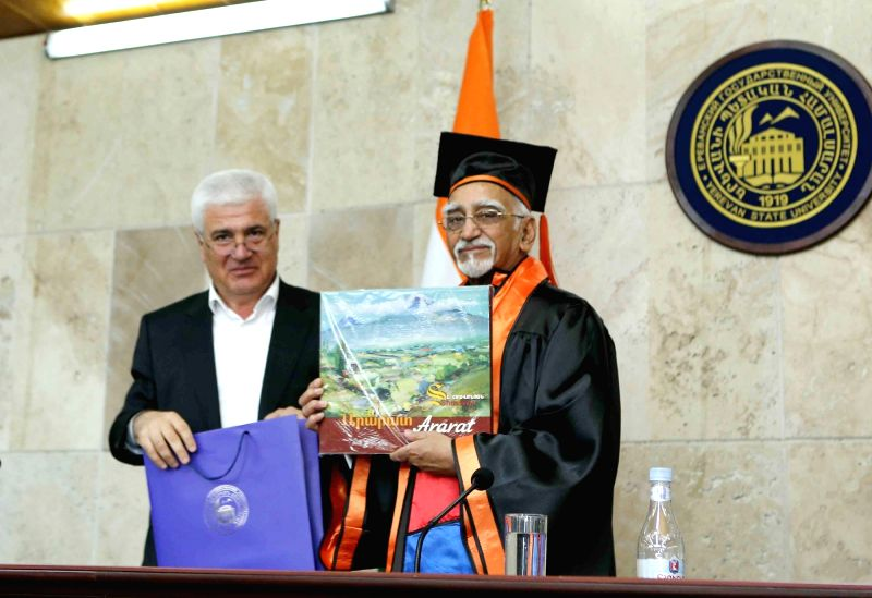 Vice President M Hamid Ansari being awarded with a degree of Honorary Doctor of the Yerevan State University in Yerevan, Armenia on April 26, 2017. Also seen Vice-Rector of Yerevan State ...
