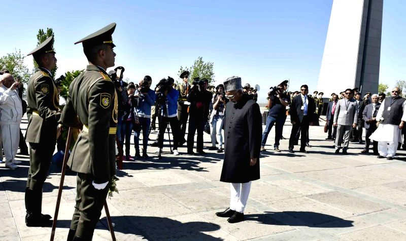 Vice President M Hamid Ansari pays homage at the Memorial of the victims of Armenian Genocide in Yerevan, Armenia on April 25, 2017. Also seen Minister of State for Micro, Small & Medium ... - Enterprises Giriraj Singh