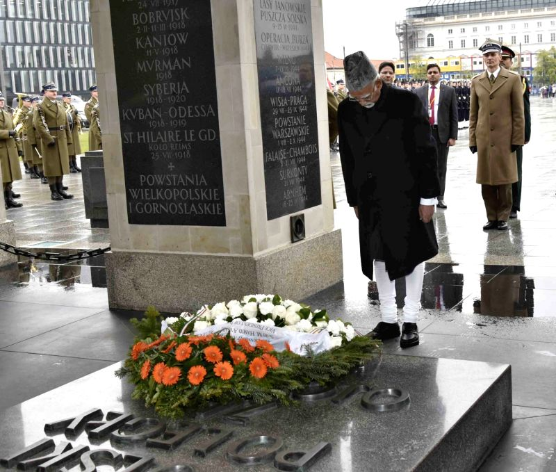 Vice President M Hamid Ansari pays homage at the Tomb of the Unknown Soldier at the Central Arcade Saxon Palace in Warsaw, Poland on April 27, 2017.