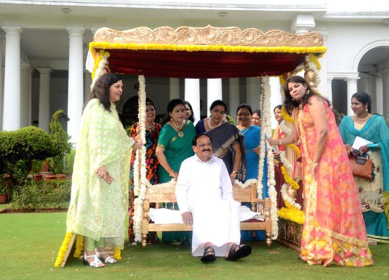 Vice President M Venkaiah Naidu celebrates Teej festival in New Delhi on Aug 11, 2018. - M Venkaiah Naidu