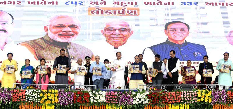 "Vice President M. Venkaiah Naidu, Gujarat Governor O.P. Kohli, Chief Minister Vijay Rupani, Deputy Chief Minister Nitinbhai Patel and other dignitaries release the book titled ""My ... - Vijay Rupani, M. Venkaiah Naidu, P. Kohli and Nitinbhai Patel"