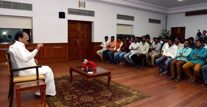 Vice President M. Venkaiah Naidu interacts with a delegation of students from Andhra Pradesh,in New Delhi, on July 26, 2018. - M. Venkaiah Naidu