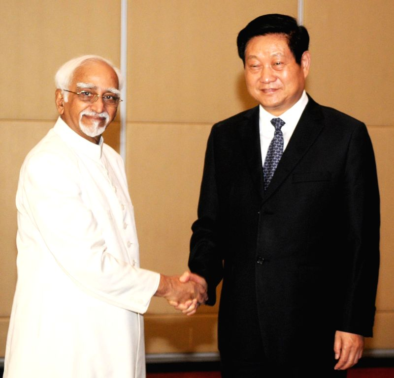 Vice-President Mohammad Hamid Ansari meets the Secretary, Shaanxi Regional Provincial Committee, Zhao Zhengyong at Xi'an in China on June 27, 2014.