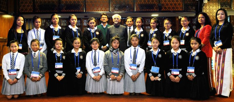 Vice President Mohd. Hamid Ansari meets  school students from Mizoram on the occasion of Kala Utsav­ 2015, in New Delhi on Dec 7, 2015.