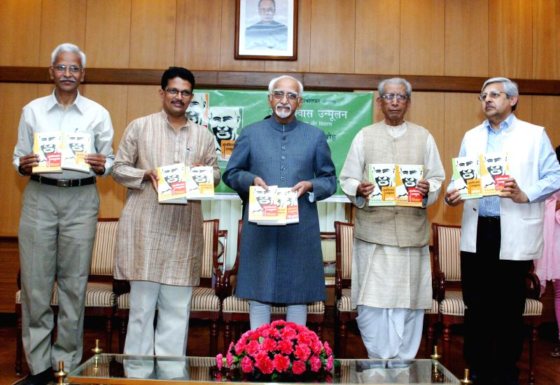 Vice President Mohd. Hamid Ansari releases the Hindi Translation of the book of late Dr. Narendra Dabholkar titled `Andhvishwas Unmoolan`, Aachaar-Volume 1, Vichaar- Volume 2, Sidhhanth-Volume 3, in ...