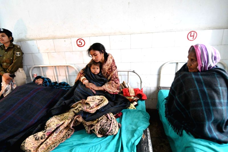 Victims of boat tragedy being treated at a government hospital at Fatuha of Bihar's Patna district on Jan 31, 2018. Five persons were killed and five went missing when a boat capsized near ...