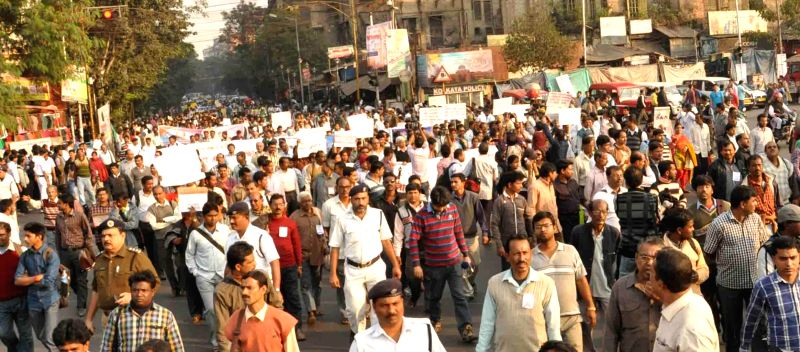Victims of chit fund scam participate in a rally in Kolkata on Dec 10, 2014.