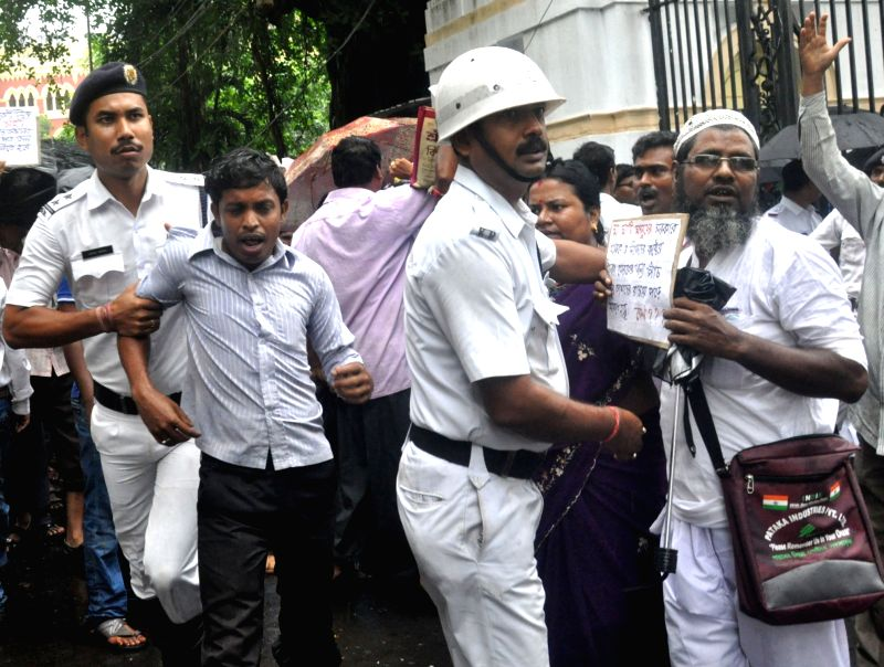Victims of Saradha chit fund scam being taken away by police during their demonstration against the state government, in Kolkata on July 26, 2018.