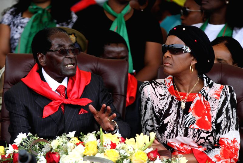 VICTORIA FALLS (ZIMBABWE), Feb. 28, 2015 Zimbabwean President Robert Mugabe (L) and his wife Grace Mugabe chat on the podium at a public celebration held to mark his 91st birthday in ...