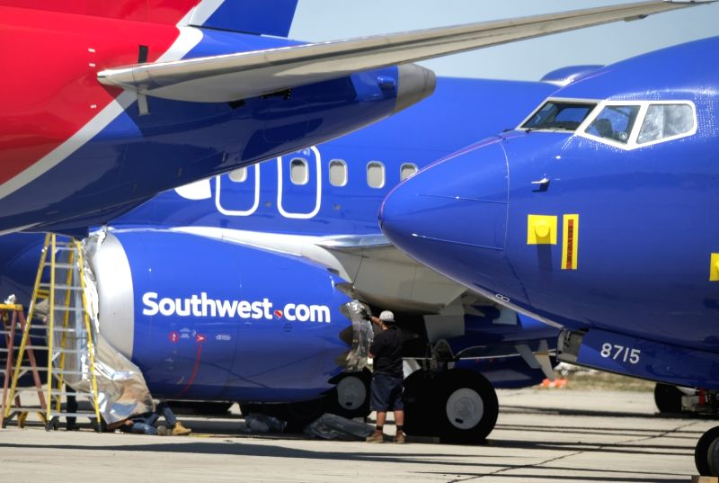 VICTORVILLE (U.S.), March 28, 2019 (Xinhua) -- A man works on a Southwest Airlines Boeing 737 Max aircraft at the Southern California Logistics Airport, also known as Victorville Airport, in Victorville, California, the United States, on March 27, 20