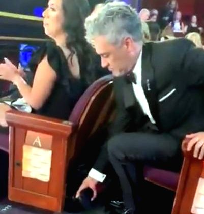 Video of Taika Waititi hiding his Oscar trophy under a seat goes viral.