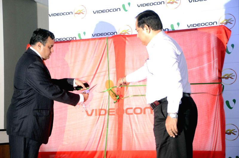 Videocon Director Anirudh Dhoot and company's COO CM Singh launch company's 4K Ultra High Definition LED TV in Mumbai on Aug 27, 2014.