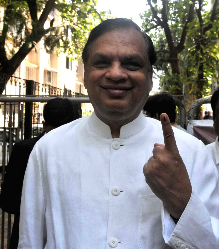 Videocon Industries Ltd chairman Venugopal Dhoot shows his fore finger marked with phosphorous ink after casting his vote at a polling booth during the sixth phase of 2014 Lok Sabha Polls in Mumbai ..