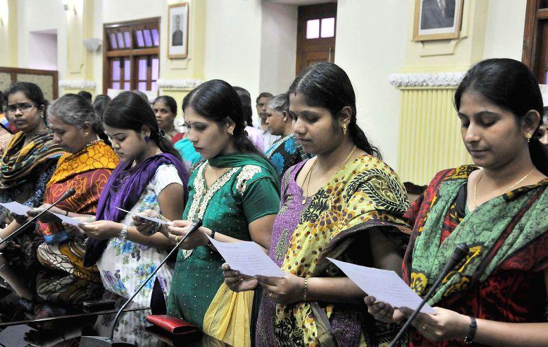 Vidhana Soudha staff takes oath during a programme organised on 70th birth anniversary of Rajiv Gandhi at Vidhana Soudha in Bangalore on Aug 20, 2014.