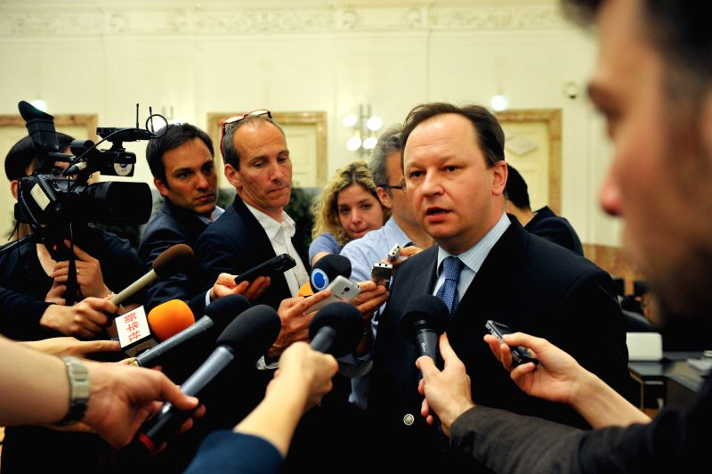 Ihor Prokopchuk (R), Ukrainian envoy to the Organization for Security and Cooperation in Europe (OSCE), talks to reporters in Vienna, capital of Austria, April 28, .