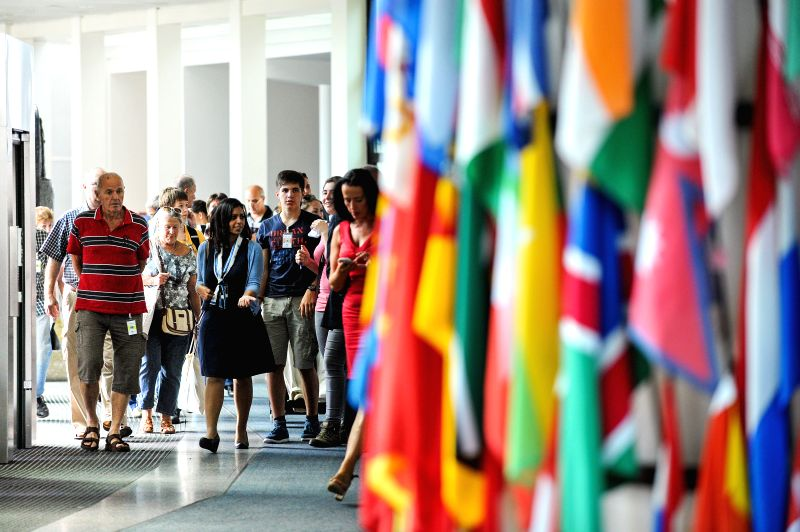 People visit the Vienna International Centre in Vienna, Austria, Aug. 15, 2014. The Vienna International Center (VIC) offered the public free guided tours on Friday.