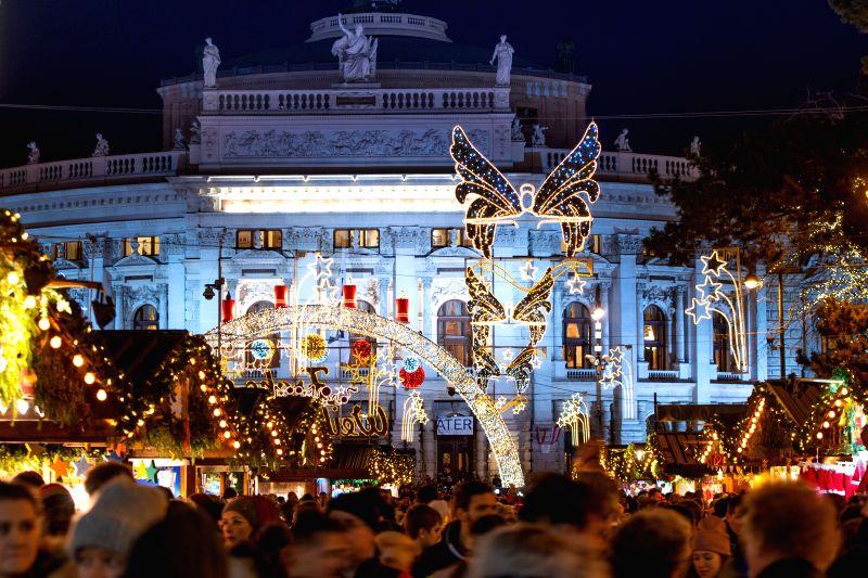 The photo shows the holiday illumination at the Christmas market on the Rathausplatz in Vienna, Austria.