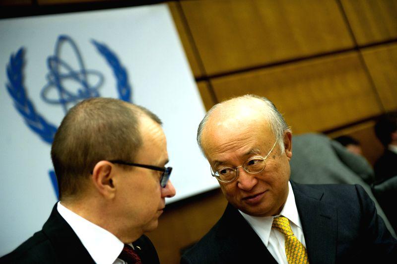 Director General of the International Atomic Energy Agency (IAEA) Yukiya Amano (R), talks with IAEA deputy director general Tero Varjoranta prior to the start of the IAEA Board of Governors' .