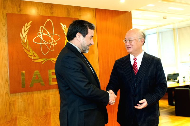 Yukiya Amano (R), director general of the International Atomic Energy Agency (IAEA), meets with senior Iranian nuclear negotiator Abbas Araqchi in Vienna, Austria, ...