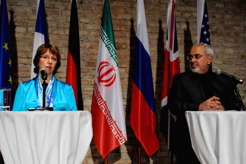 Catherine Ashton (L), the High Commissioner of European Union for Foreign Affairs and Security Policy, together with Iran's Foreign Minister and chief negotiator ...
