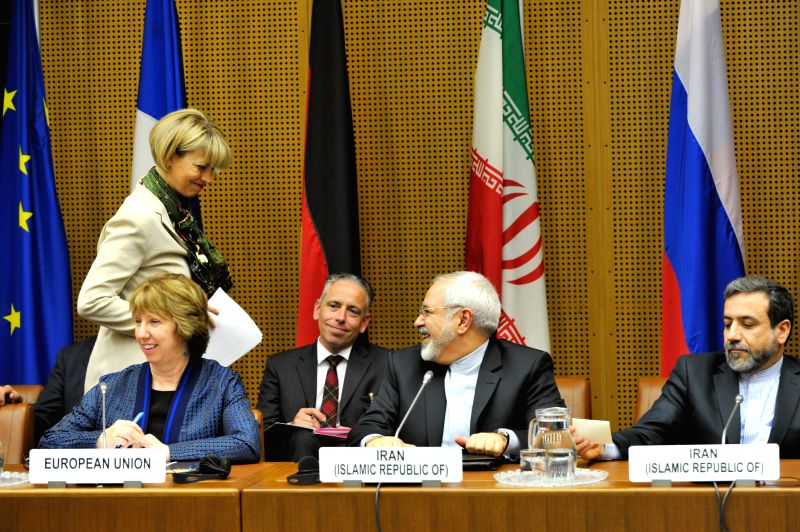 Iran's chief negotiator and Foreign Minister Mohammad Javad Zarif (2nd R) and EU foreign policy chief Catherine Ashton (1st L, front) attend the meeting in Vienna, .. - Mohammad Javad Zarif