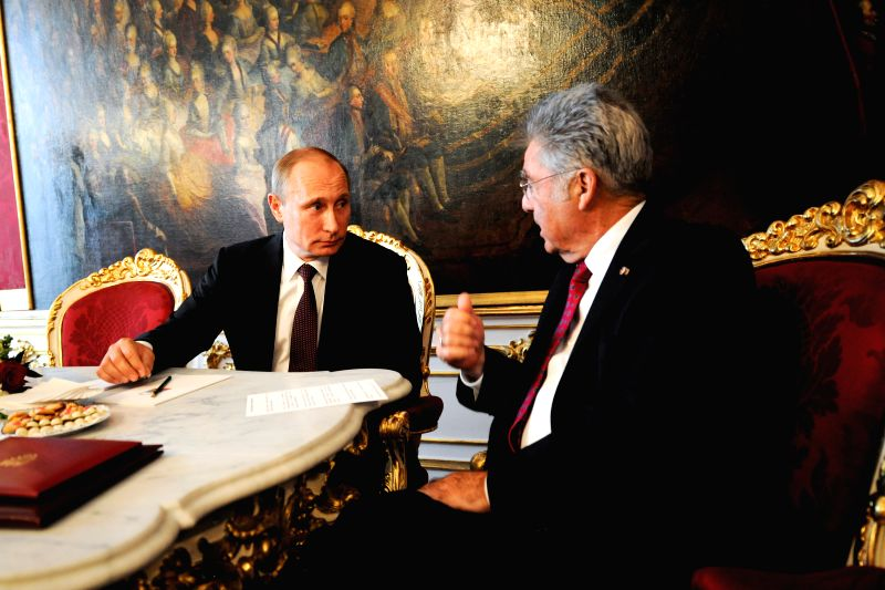 Austrian President Heinz Fischer (R) meets with visiting Russian President Vladimir Putin in Vienna, Austria, on June 24, 2014.