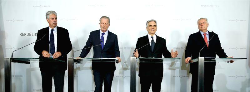 Austrian Chancellor Werner Faymann (2nd R), Austrian Vice Chancellor and Minister of Economy Reinhold Mitterlehner (2nd L), Austrian Social Affairs Minister Rudolf ... - Rudolf Hundstorfer