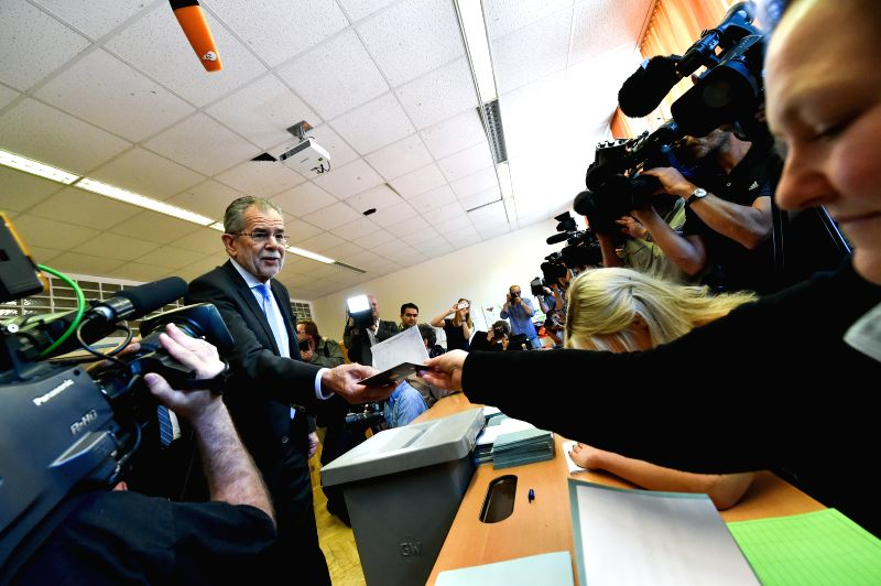 VIENNA, May 22, 2016 - Presidential candidate Alexander Van der Bellen (L) casts his vote at a polling station during the Austrian presidential elections in Vienna, Austria, May 22, 2016.