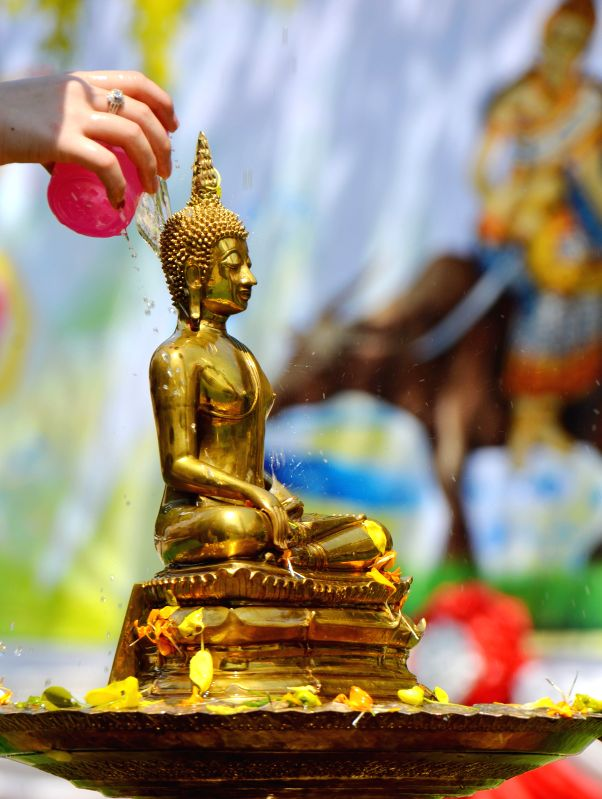 People pay respect for Buddha at a water festival in Vientiane, capital of Laos, April 14, 2017. Songkran festival, also known as water festival, is celebrated in Laos as the traditional New Year's Day.
