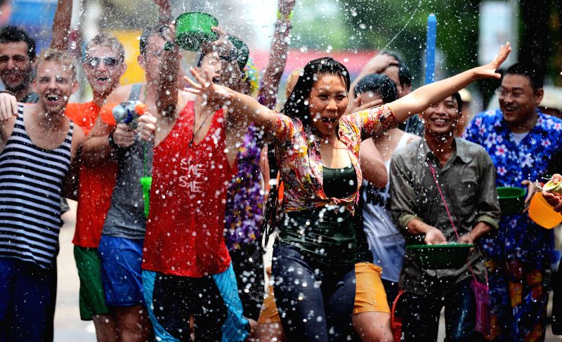 People splash water to each other while celebrating Songkran, the water festival in Vientiane, capital of Laos, April 14, 2014. Songkran festival, also known as .