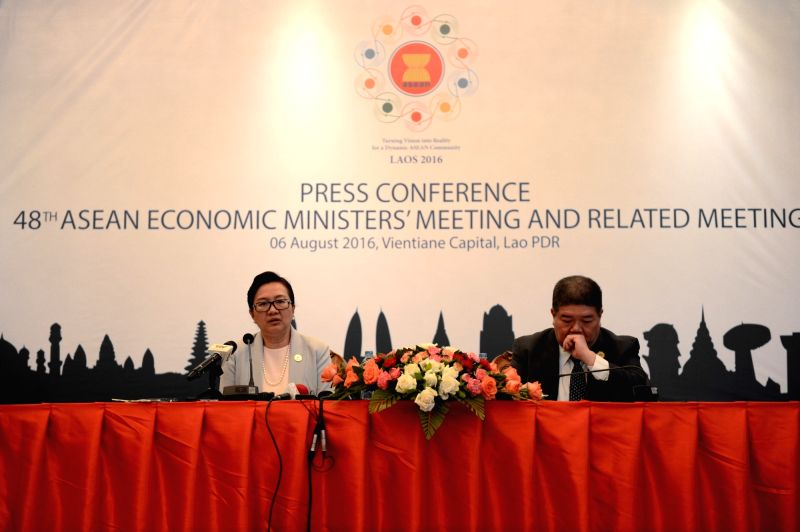 VIENTIANE, Aug. 7, 2016 - Lao Minister of Industry and Commerce Khemmani Pholsena (L) addresses a press conference after the ASEAN Economic Ministers' Meeting (AEM) and related meetings in Vientiane, ...