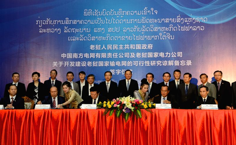 VIENTIANE, Aug. 9, 2018 - Delegates sign a Memorandum of Understanding (MOU) in the Lao capital Vientiane on Aug. 8, 2018. China Southern Power Grid (CSG) has signed a MOU over feasibility study on ...