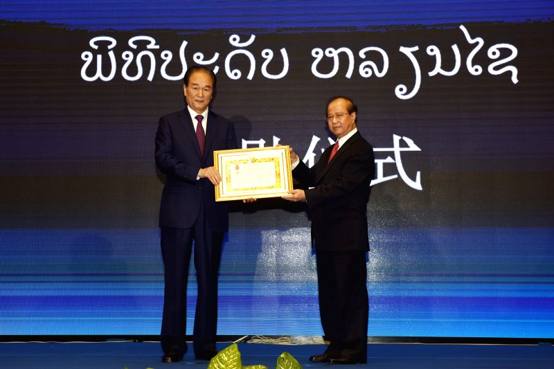 VIENTIANE, Feb. 2, 2018 - China's Xinhua News Agency and Xinhua President Cai Mingzhao (L) are awarded freedom medals by the Lao government during the opening ceremony of Laos-China Belt and Road ...