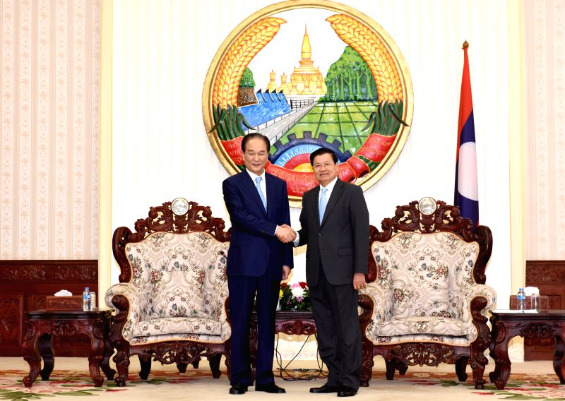VIENTIANE, Feb. 2, 2018 - Lao Prime Minister Thongloun Sisoulith meets with Xinhua News Agency President Cai Mingzhao on relations and bilateral media cooperation, in Vientiane, Laos, on Feb. 2, 2018. - Thongloun Sisoulith
