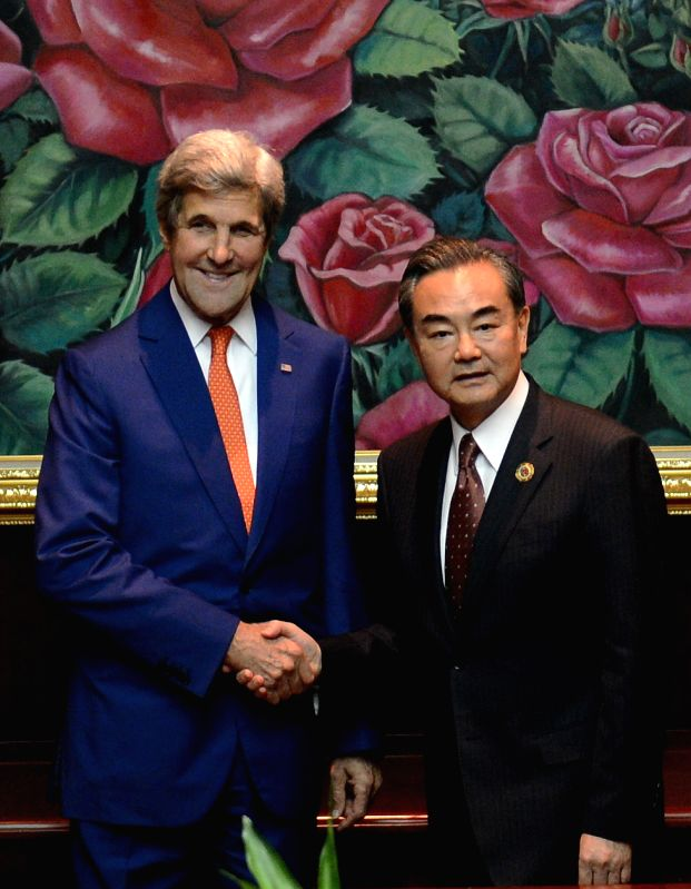VIENTIANE, July 25, 2016 - Chinese Foreign Minister Wang Yi(R) meets with U.S. Secretary of State John Kerry in Vientiane, capital of Laos on July 25, 2016. Chinese Foreign Minister Wang Yi said on ... - Wang Y