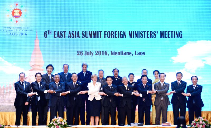 VIENTIANE, July 26, 2016 - Participants pose for a group photo before the 6th East Asia Summit Foreign Ministers' Meeting in Vientiane, capital of Laos, July 26, 2016.