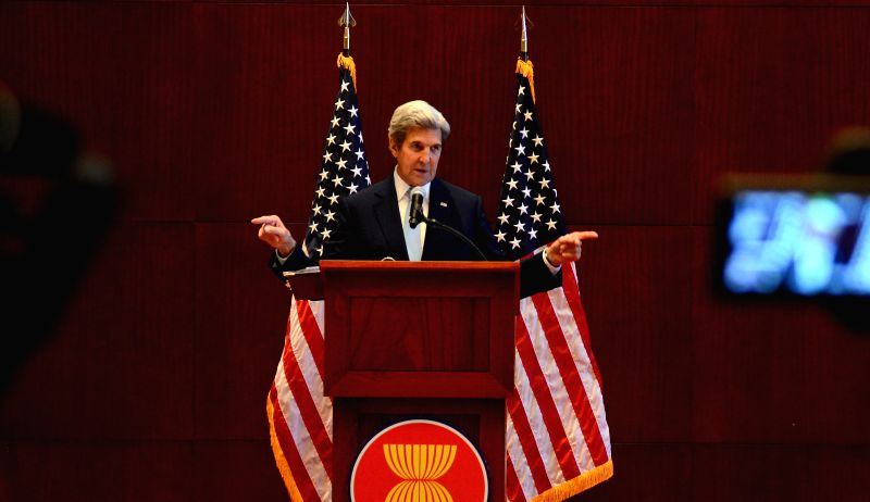 VIENTIANE, July 26, 2016 - U.S. Secretary of State John Kerry addresses a press conference following a series of meetings including with Chinese Foreign Minister Wang Yi and counterparts from 10 ... - Wang Y