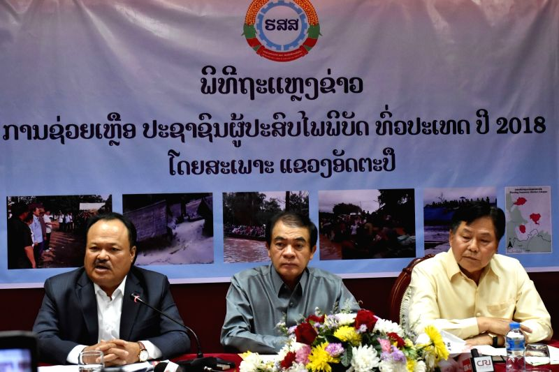 VIENTIANE, July 26, 2018 - Khammany Inthirath (1st L), Lao Minister of Energy and Mines, speaks at a press conference in Vientiane, Laos, July 26, 2018. Lao government officials said on Thursday that ...