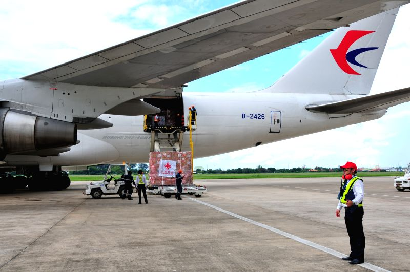 VIENTIANE, July 31, 2018 - The emergency relief from Chinese government to Laos is unloaded from a Chinese cargo plane at the Wattay International Airport, in Lao capital Vientiane, on July 30, 2018. ...